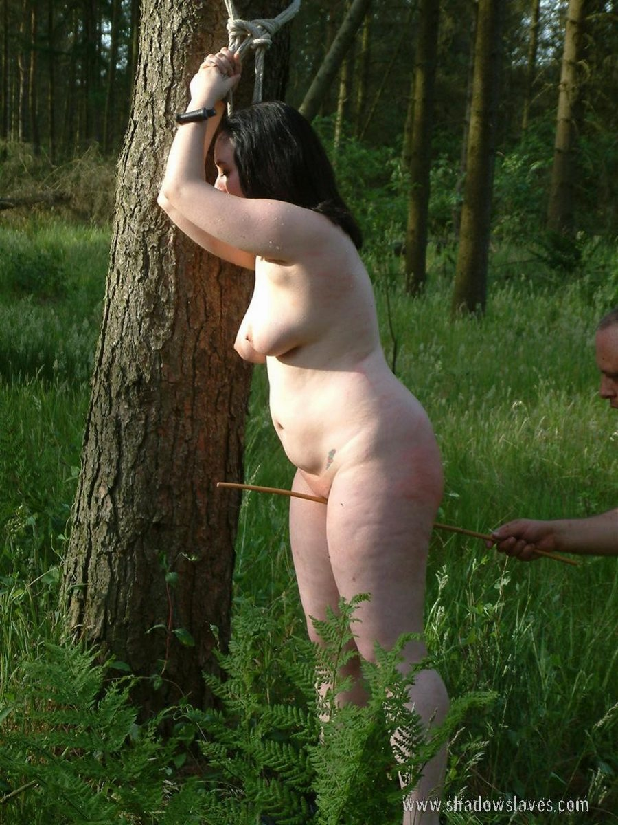 Woman being whipped and punished