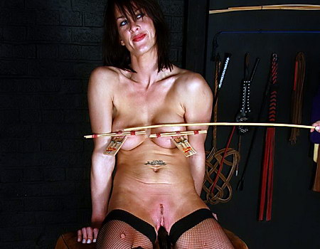 Gruesome nipple torments and breast caning punishment of busty bdsm slave Daniela in the dungeon of pain from The Pain Files