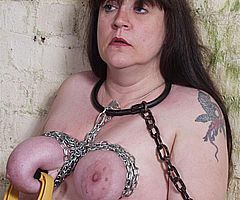 Breast torments of mature dungeon slavegirl Jay in chains and severe tit punishments from Shadow Slaves