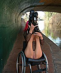 Wheelchair pornstar Leah Caprice flashing nude in public and busty handicapped redheads outdoor striptease from UK Flashers