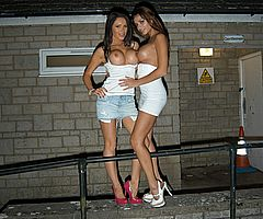 Two busty british lesbian pornstar in public nudity showing off their giant boobs and enjoying the outrage of nighttime flashing outdoor in Bristol from UK Flashers