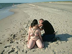 Two slavegirls tied together on the public bondage beach from Shadow Slaves